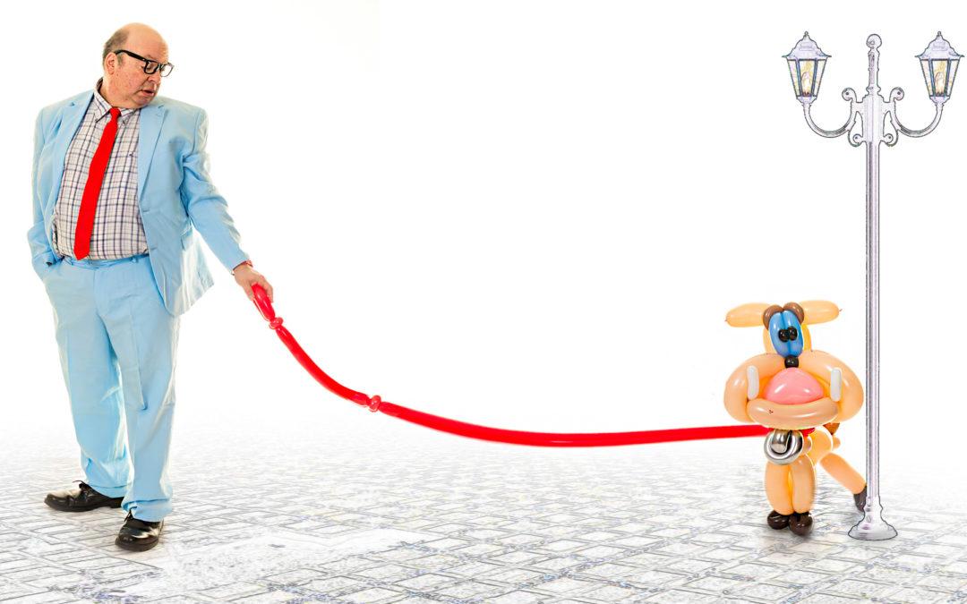 Danny the Idiot walking the balloon dog